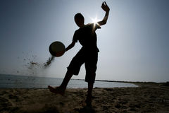 Football on beach Stock Photos