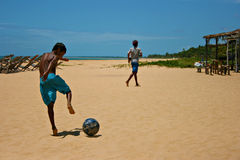 Football on the beach Stock Images