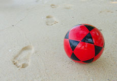 Football on beach for Soccer sport Royalty Free Stock Image