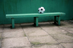 Football on bench. Football on a green bench Royalty Free Stock Photography
