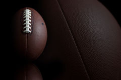 Football on black Stock Photos