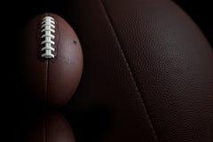 Football on black stock photos