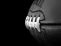 Football in black and white. Close up of a football in black and white. Focus on the second seam Royalty Free Stock Image