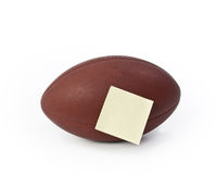 Football with blank note Stock Photo