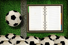 Football and blank notebook Royalty Free Stock Photos