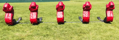 Football blocking sled. A five person football blocking sled on a grass field Stock Image