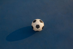 Football on blue background Royalty Free Stock Photography