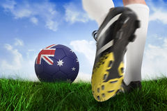 Football boot kicking australia ball Stock Images