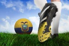 Football boot kicking ecuador ball. Composite image of football boot kicking ecuador ball against field of grass under blue sky Stock Photos