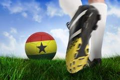 Football boot kicking ghana ball. Composite image of football boot kicking ghana ball against field of grass under blue sky Stock Photography