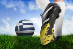 Football boot kicking greece ball. Composite image of football boot kicking greece ball against field of grass under blue sky Stock Photo
