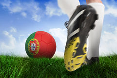 Football boot kicking portugal ball Royalty Free Stock Image
