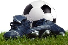 Football and boots royalty free stock photo