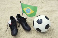 Football Boots Brazilian Flag Soccer Ball on Sand Stock Photo