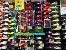 Football boots at Decathlon, Bucharest. Romania. Decathlon is a manufacturer and distributor of sporting goods, sports equipment and clothing in France, based royalty free stock photography