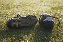Football boots on a empty football pitch. Frosty winter morning Stock Photos
