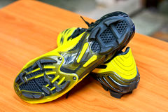 Football boots. Soccer boots, yellow color. On  wood table Stock Photo