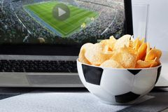 Football bowl of chips at a computer with video Stock Photography