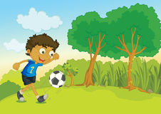 Football boy. Illustration of a young boy kicking a football in a park Stock Photography
