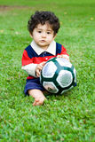 Football boy. Cute baby boy with football royalty free stock image