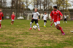 Football boy controling the ball Royalty Free Stock Photos