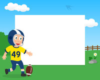 Football Boy in the Park Horizontal Frame Royalty Free Stock Images