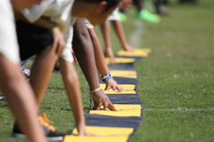 Football Camp. Kids preforming skills and drills during a football camp Royalty Free Stock Photos