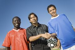 Football Captains With Referee. Low angle view portrait of football captains with referee Stock Photo