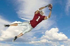 Football Catch With Clouds Royalty Free Stock Images