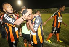 Football celebration. Perseru Serui player celebrating their victory against Persik Kediri in Indonesia Premier League Semi Final in Manahan Stadium, Solo Stock Photo
