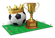 Football championship concept. Golden trophy cup and soccer ball with crown on green soccer field isolated on white background Stock Photo