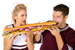Football: Cheerleader Annoyed That Man Is Eating Stock Images