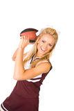 Football: Cheerleader Throwing Ball Royalty Free Stock Images