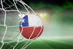 Football in chile colours at back of net Stock Images