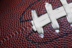 Football. Close up of an american football against a black background Stock Photo