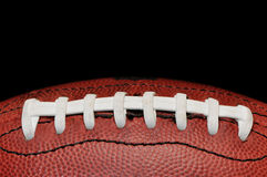 Football Closeup Isolated on Black Stock Photo