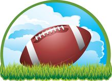 Football on cloud background. Football sitting on open field Stock Image