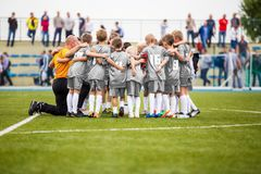 Football Coaching. Young Boys Having Pep Talk with Coach Before the Tournament Match. Kids Soccer Academy Team on the Pitch. Youth Soccer Coach Coaching Stock Photos