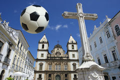 Football at Colonial Christian Cross in Pelourinho Salvador Bahia Brazil. Football flying above Cruzeiro de Sao Francisco Anchieta colonial Christian cross in Royalty Free Stock Images