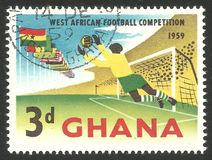 Football Competitions, Flags and goalkeeper. Ghana - stamp printed 1959, Multicolor Memorable issue of Photogravure printing, Topic Sport and Football, Series royalty free stock image