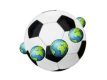 Football concept. Earth globes around the soccer ball Royalty Free Stock Images