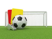 Football concept. Penalty (red and yellow) card, metal whistle and soccer (football) ball and gate Royalty Free Stock Photography