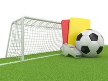 Football concept. Penalty (red and yellow) card, metal whistle and soccer (football) ball and gate Royalty Free Stock Images