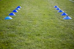 Football Cone. A football cones placed on the pitch ready to be used for football training royalty free stock photography