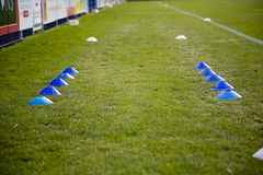 Football Cone. S placed on the pitch ready to be used by the players for football training royalty free stock photography