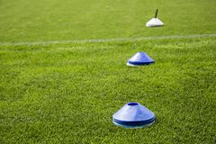 Football Cones. Placed on the football pitch ready to be used for training or warm up exercises stock photos