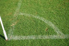 Football corner on green grass. Sign fot soccer Stock Photography