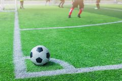 Football on corner for corner kick. With blurry kid players royalty free stock image