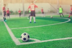 Football on corner for corner kick. With blurry kid players royalty free stock photography