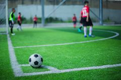 Football on corner for corner kick. With blurry kid players royalty free stock photos